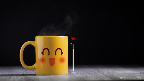 Yellow mug contains the hot coffee. with cute smile face animation, metaphor drink coffee for more Live Action