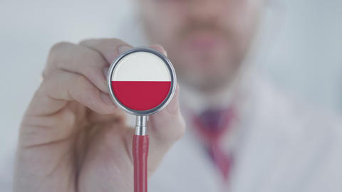 Doctor uses stethoscope with the Polish flag. Healthcare in Poland Live Action