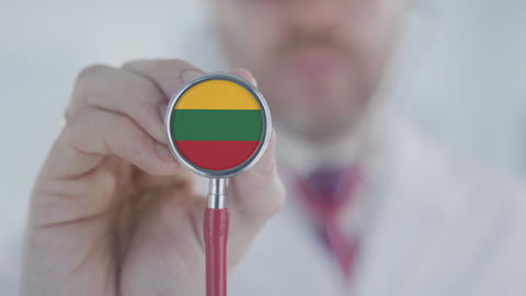 Doctor holds stethoscope bell with the Lithuanian flag. Healthcare in Lithuania Live Action