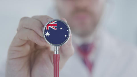 Doctor uses stethoscope with the Australian flag details. Healthcare in Live Action