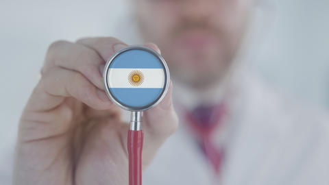 Doctor uses stethoscope with the Argentinean flag. Healthcare in Argentina Live Action