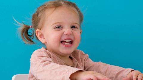 Beautiful little girl hiding in studio Live Action