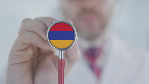 Physician listening with the stethoscope with flag of Armenia. Armenian Live Action