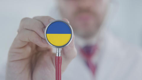Doctor listening with the stethoscope with flag of Ukraine. Ukrainian healthcare Live Action