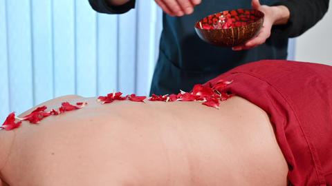 Relaxing woman in a spa with petal of flowers on her back, Beautiful woman Live Action