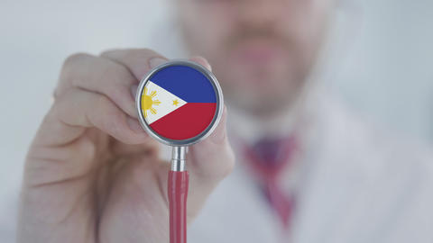 Doctor listening with the stethoscope with flag. Healthcare in the Philippines Live Action
