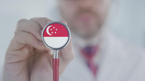 Doctor listening with the stethoscope with flag of Singapore. Singaporean Live Action