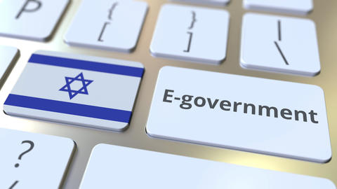 E-government or Electronic Government text and flag of Israel on the keyboard Live Action