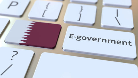 E-government or Electronic Government text and flag of Qatar on the keyboard Live Action