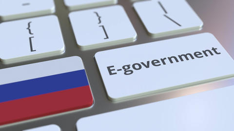 E-government or Electronic Government text and flag of Russia on the keyboard Live Action
