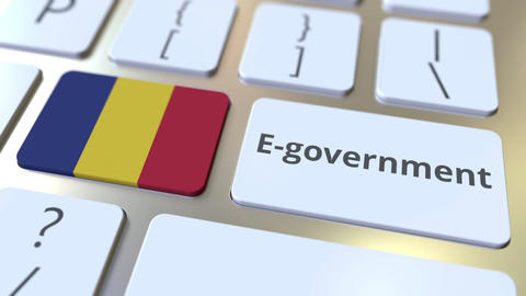 E-government or Electronic Government text and flag of Romania on the keyboard Live Action
