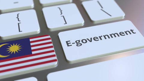 E-government or Electronic Government text and flag of Malaysia on the keyboard Live Action