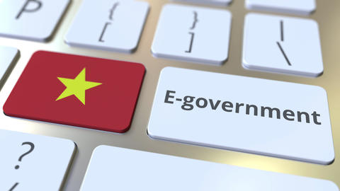 E-government or Electronic Government text and flag of Vietnam on the keyboard Live Action