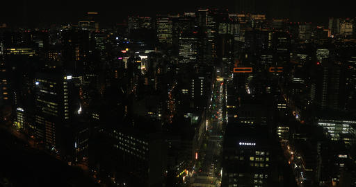 A cityscape from rising elevator at the urban city in Tokyo wide shot high angle Live Action