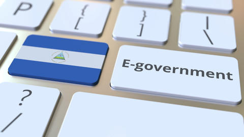E-government or Electronic Government text and flag of Nicaragua on the keyboard Live Action