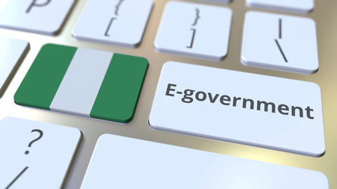 E-government or Electronic Government text and flag of Nigeria on the keyboard Live Action