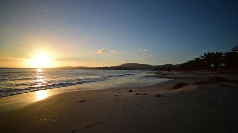 Sunset in Alghero shore on a clear day. Sardinia, Italy Live Action