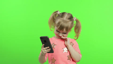 Little girl using smartphone. Child with smartphone… Stock Video Footage