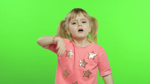 Positive girl emotionally make faces and smile in pink blouse. Chroma Key Live Action