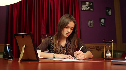 Businesswoman making notes, signing documents in her office Footage