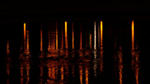 4K Ungraded: Ducks Swimming on Water Surface Reflections Among Orange City At Footage