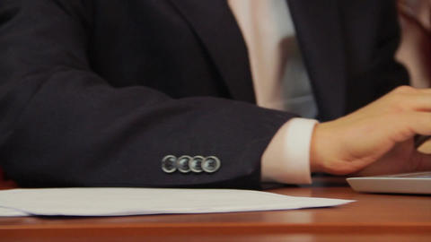 Businessman signs papers, contract, agreement, works on laptop Footage