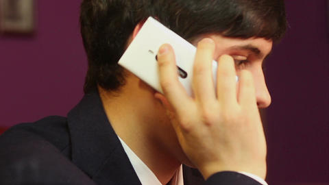 Office worker talking to family on the phone, making appointment Footage