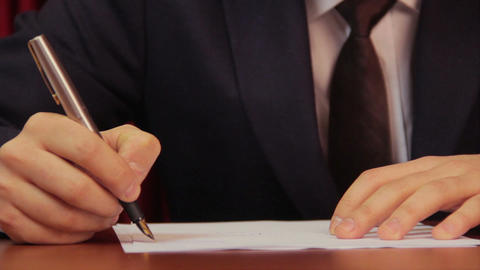 Businessman signing a contract, agreement, working in office Footage