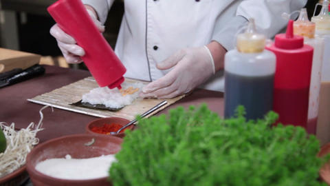 Chef making Japanese sushi roll with red caviar, cooking process Footage