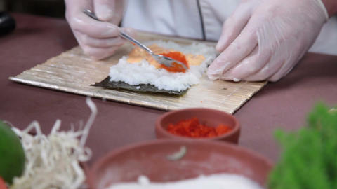 Cook making Japanese sushi rolls with caviar, cooking process Footage