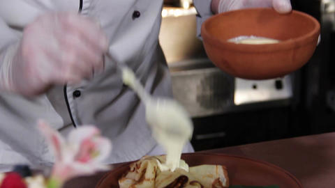 Chef making delicious pancakes with cream, berries and jelly Footage