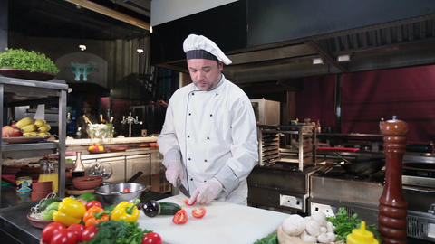 Chef working in the kitchen, slicing fresh delicious vegetables Footage
