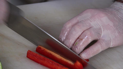 Close-up cook's knife chopping juicy red pepper, cooking process Footage