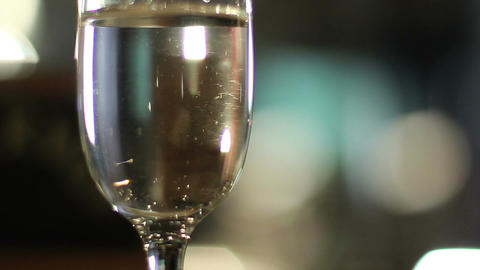 Glass filled with sparkling champagne on a restaurant table Footage
