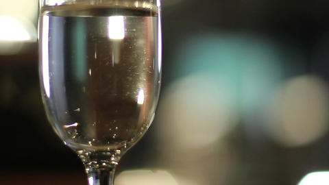 Sparkles of light reflecting on a glass full of champagne Footage