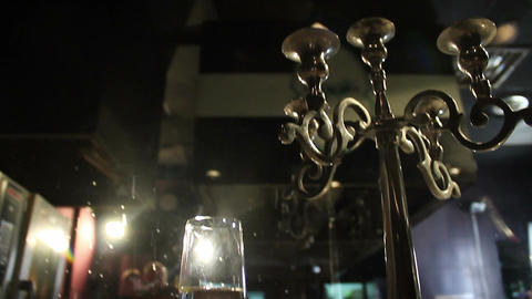 Vintage chandelier on reserved table, glass full of champagne Footage