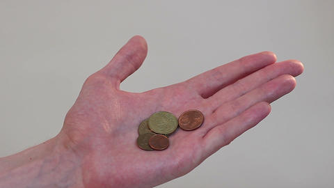 Hand holding a few coins, poverty, little income, family budget Footage