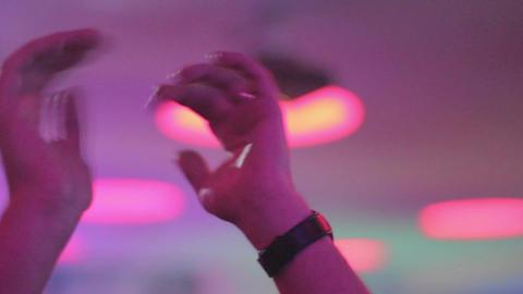 Man waving hands to rhythm of club music, nightclub atmosphere Footage
