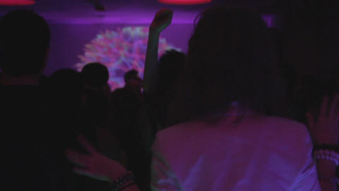 Young girl on the dance floor, having fun, nightclub atmosphere Live Action