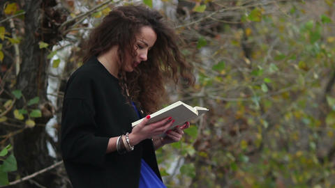 Girl reads captivating book, old school, traditional technology Live Action