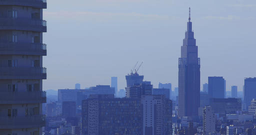 A high angle cityscape at the urban city in Tokyo long shot daytime Live Action