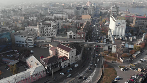 Kyiv / Ukraine - October 25 2019: Foggy old city Podil aerial high angle traffic in smog pollution Live Action