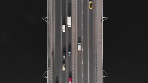 Highway bridge traffic aerial top view high speed time-lapse cars Live Action