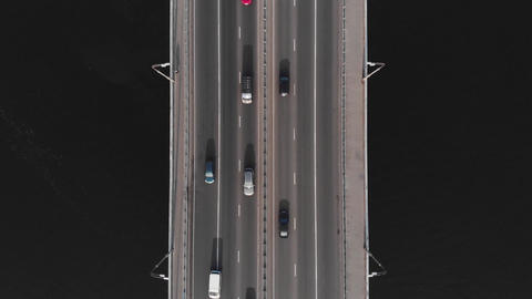 Highway bridge traffic aerial top view cars passing medium speed Live Action