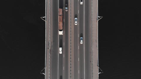 Timber truck on bridge highway in traffic aerial top view Live Action