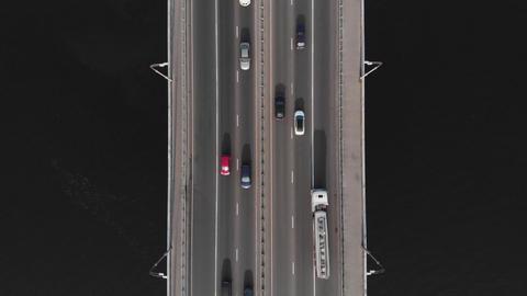 Bridge highway dark water cars traffic aerial top view hover shot Live Action