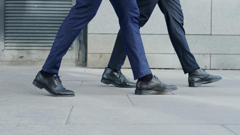 Unrecognizable businessmen taking walk on road. Business people going for job Live Action