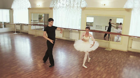 Graceful couple dancing ballet simultaneously in front of mirror Footage