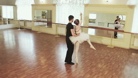 Couple dancing ballet gracefully, male spinning female around Footage