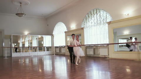 Pas de deux, female male ballet dancers taking steps together Footage